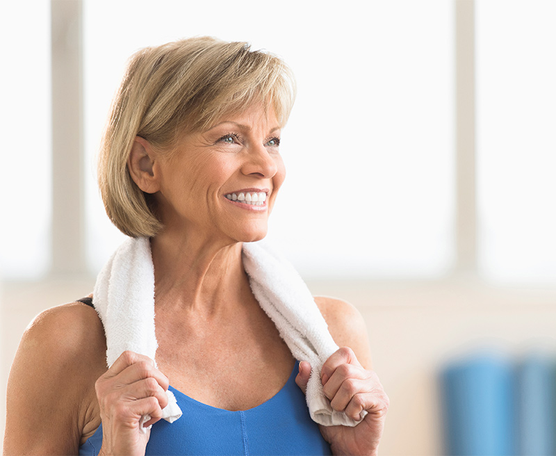 Older woman smiling and active at a gym